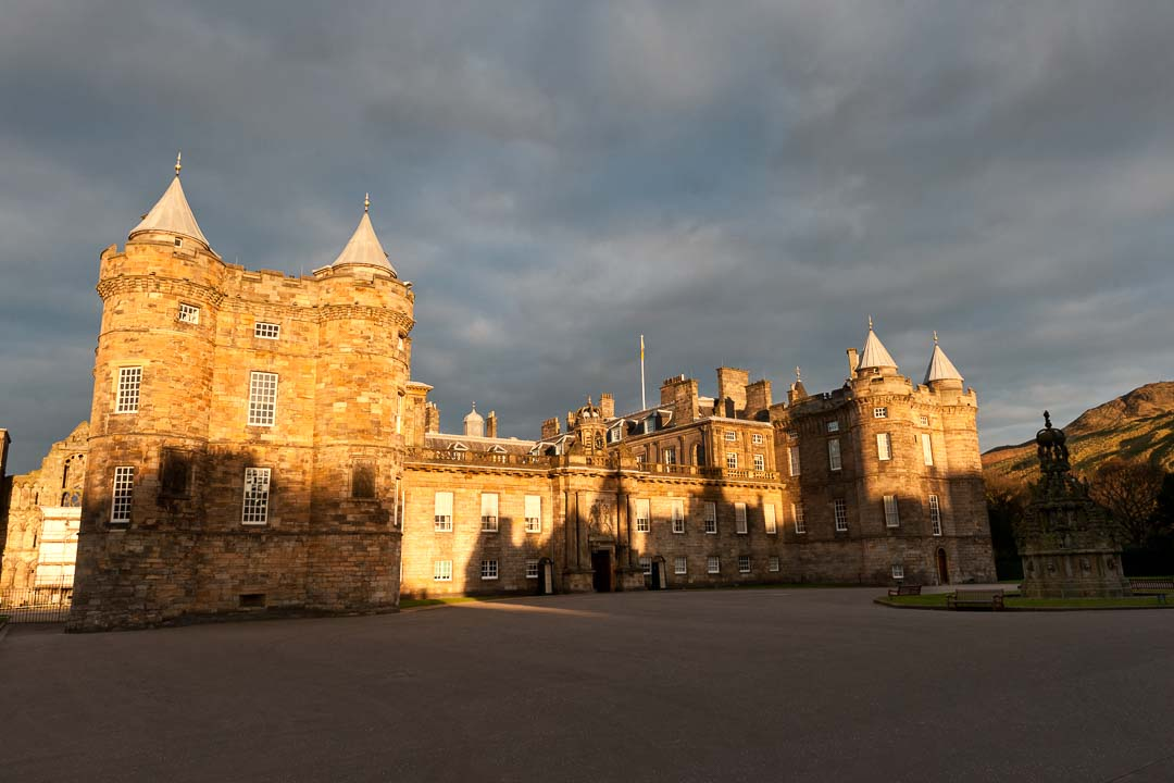 Holyrood Palace at the bottom of Edinburgh's Royal Mile in late afternoon sun.